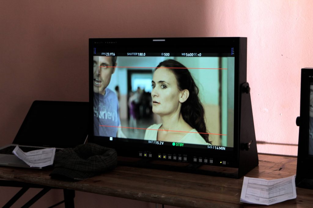 Still of Greta Zenelaj filming Eagle in Albania. monitor film