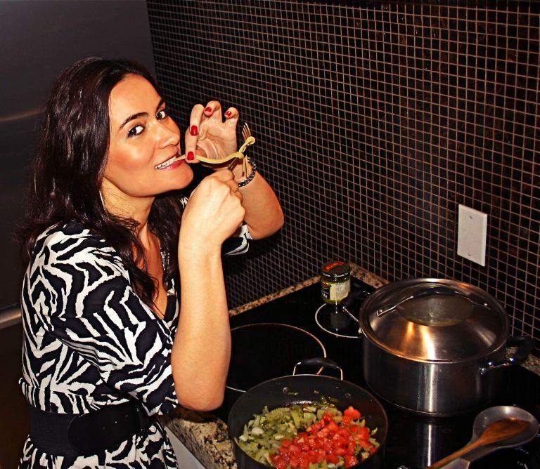 Greta-Zenelaj-award_winning-Actress-founder-of-Colored-Films-llc- eating pasta